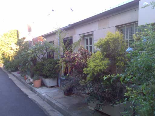 Surry Hills, Sydney: It's a great little street directly parallel to Fitzroy Street where the residents have banded together to ban cars and to decorate their former-slum-street with beautiful gardens. The result has been a physically beautiful street, and one which has a great sense of community pride.