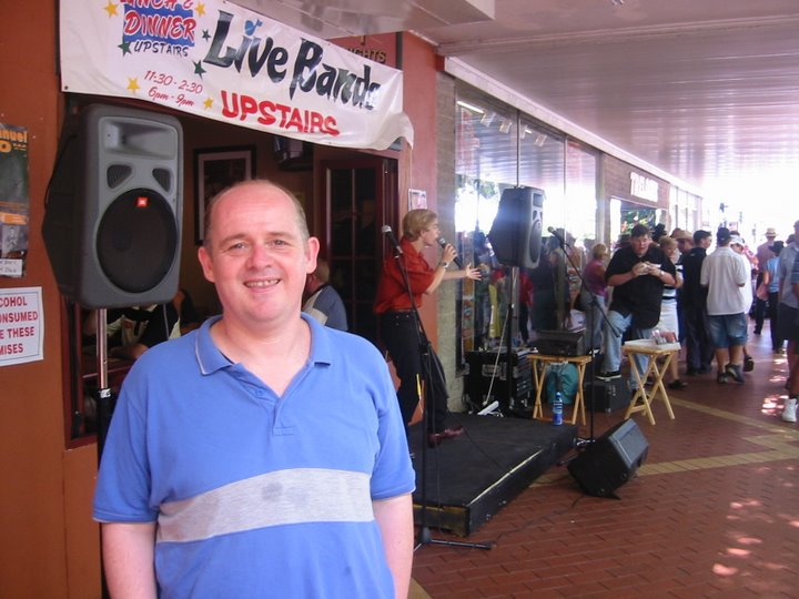 On the streets of Tamworth with a busker behind