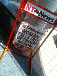 NT News - woman falls out of paddy wagon