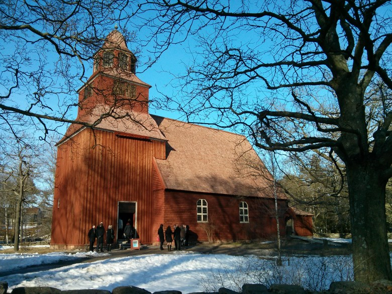 Wedding party goes into church at Skansen