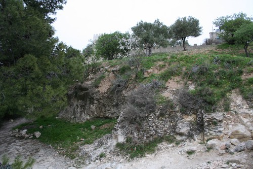 "The bedrock outcropping at the Summit of the Mt of Olives where the Romans crucified their victims in ""front of the city"" facing the Temple Mount."