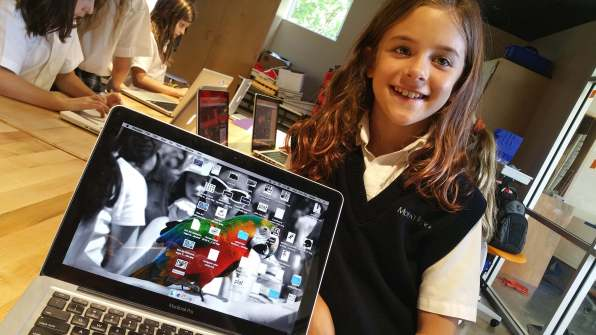 A proud artist shares her work as the background of the Studio(i) laptops.