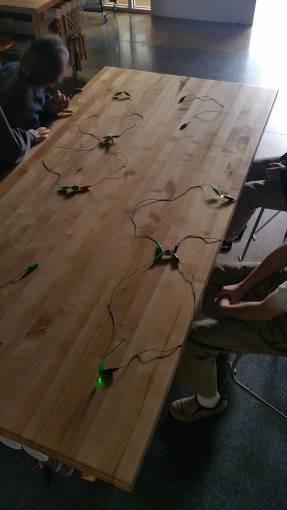 More parallel circuits completed, with LEDs lighting the darkened room.