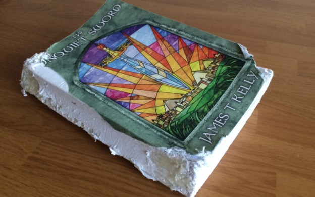 A damaged copy of The Unquiet Sword paperback; a dog ate it!