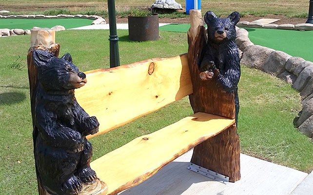 Take a rest on a beautiful wooden bench guarded by Mama Bear and Baby Bear, gorgeously hand-hewn by the husband and wife team at T&D Carving form Pennsfield, PA.