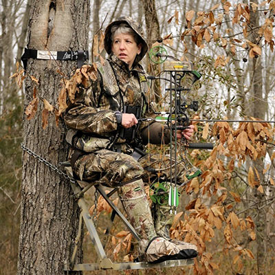Vikki Trout, pictured in a treestand, represents a positive voice for female hunters