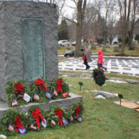 The center monument in Soldier's Circle in Lake View Cemetery is adorned with wreaths to remember the fallen.
