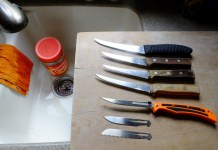 Home butchering requires only a few simple tools. Sharp knives and a solid cutting surface are all you need. The Havalon knife has three different blades. Do it near running water and keep a rag handy. Inedible waste goes into the empty peanut butter jar.