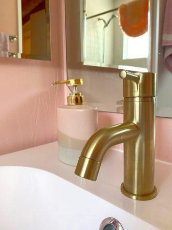 Gold faucet in modern bath