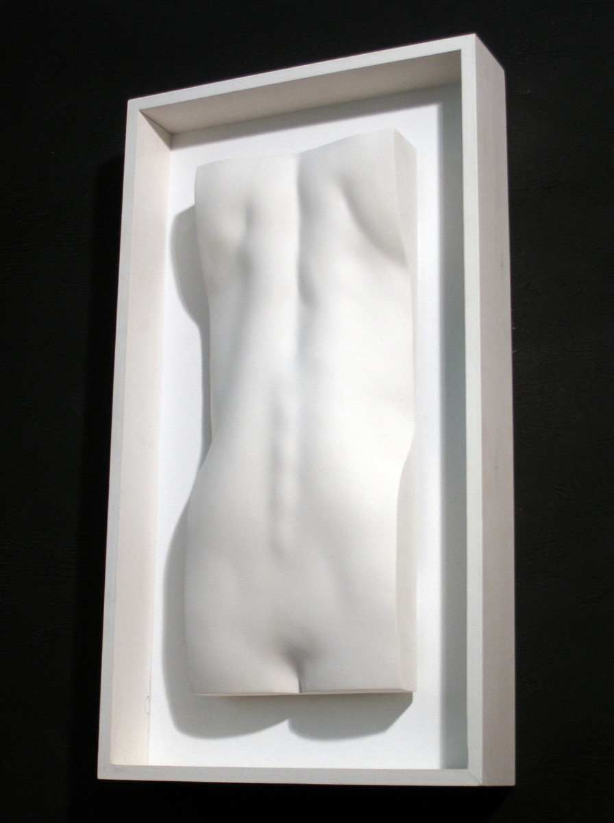 Framed female back sculpture in plaster
