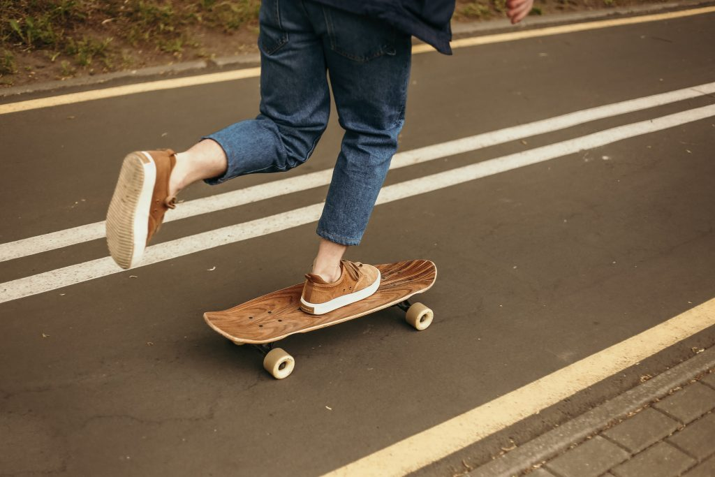 photo of a pair of legs on a skateboard - goal setting for entrepreneurs includes doing fun things for yourself