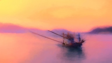 A fishing trawler returns home to Rawai in the early morning mist with the night's catch