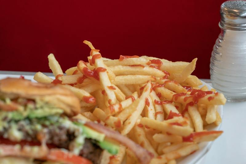 Close up of burger and fries with salt