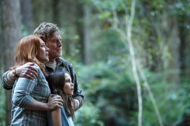 Bryce Dallas Howard is Grace, Robert Redford is Mr. Meacham and Oona Laurence is Natalie in Disney's PETE'S DRAGON, the adventure of an orphaned boy and his best friend Elliott, who just so happens to be a dragon.