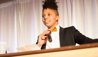 Jayana Khan, an activist and kickboxer, speaks at the fourth annual Queering Black History Month event on Friday.