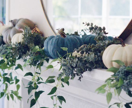 Blue and white pumpkins and greenery on the mantel #falldecor #mantel #mantle