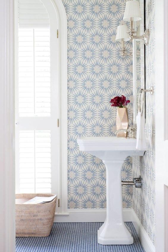 Love, love the beautiful wallpaper in this charming blue and white powder bath #bathroom #bathroomdecor #bathroomwallpaper #wallpaper #bluedecor #powderbath