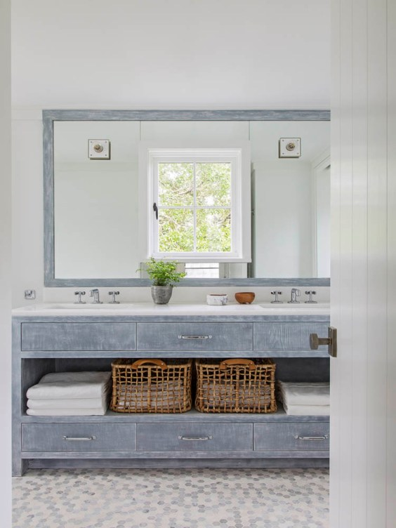 Beautiful beach house bathroom design with gray vanity and white accents from Jenny keenan design #bathroomdecor #bathroomdesign #bathroomremodel #coastalbathroom #bathdesign