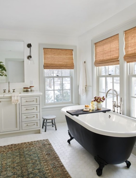 Beautiful modern traditional bathroom design with black free standing tub - Amber Interior Design - bathroom ideas - bathroom decor - bathroom remodel