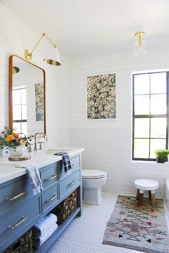 Beautiful modern bathroom idea with blue vanity and shiplap walls - Juniper Home