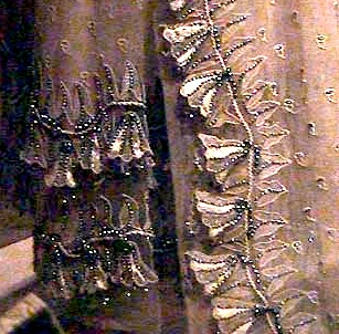 Detail of bells and net embroidery
