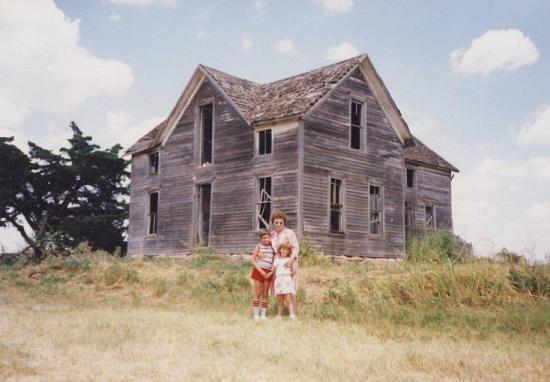 Benjamin Vogt with family, standing in front of the homestead (1980s)