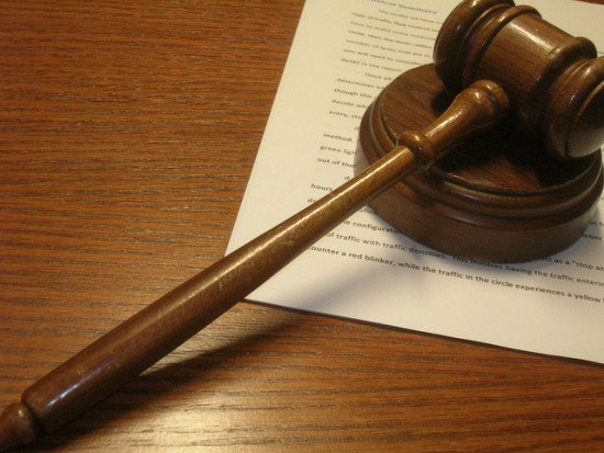 Photograph of a judge's gavel on a desk with some paperwork