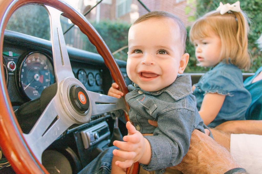 Baby boy driving corvette