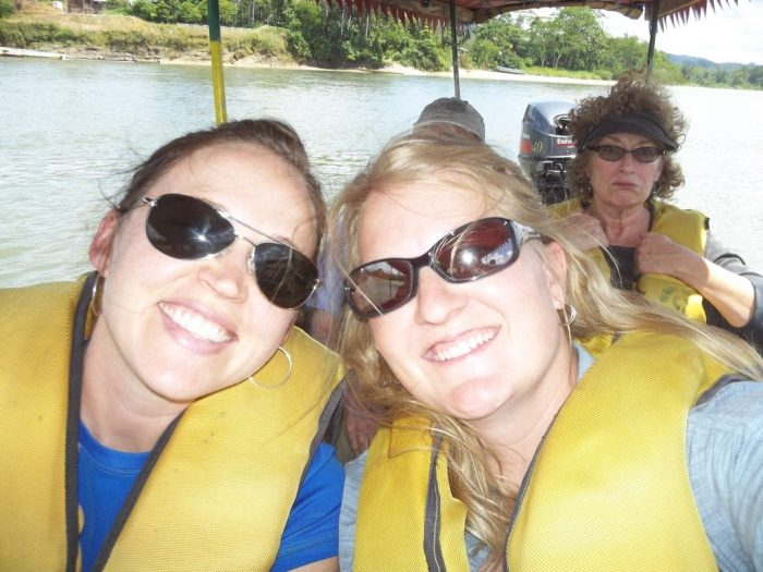 Canoeing the river in Ecuador, tour group challenges, friends, yellow life vests