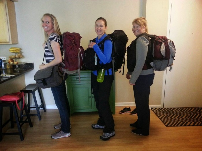 Three friends with backpacks packing light tips and tricks for women travelers