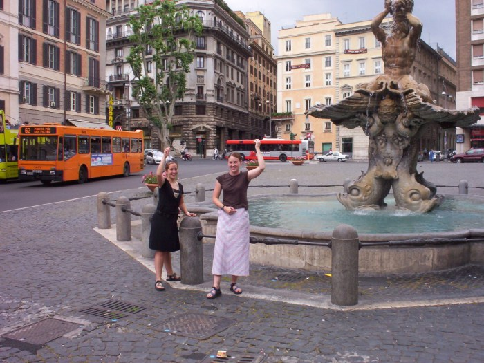 Throwing coins in a fountain in Rome