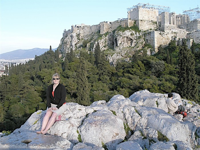 Sitting on rocks in front of the Parthenon in Athens, Greece websites for planning a trip women who travel vacation