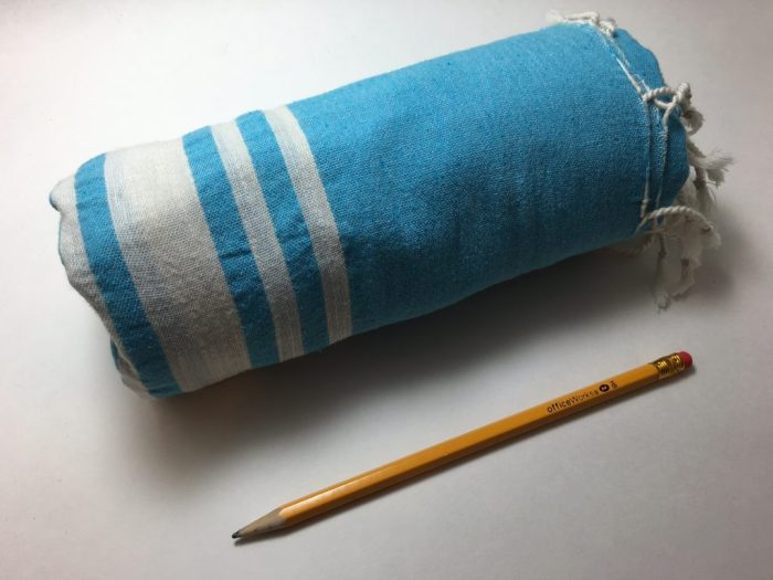 packing light tools, blue Turkish towel next to a pencil