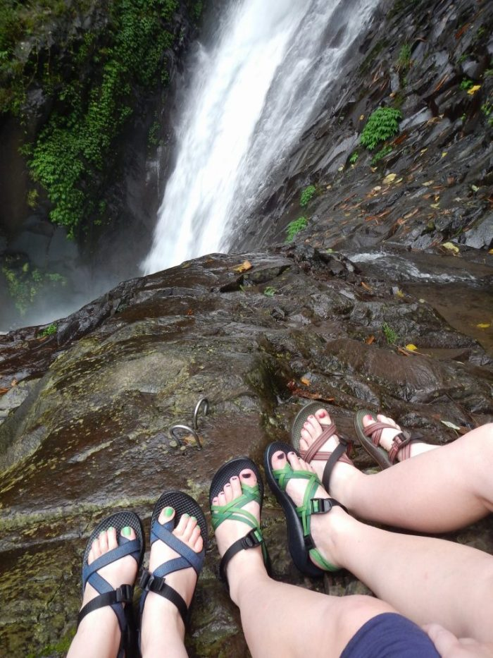 Feet in front of a waterfall