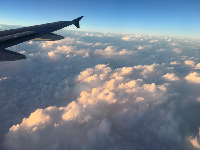 Clouds from a plane window, not-so-fun travel