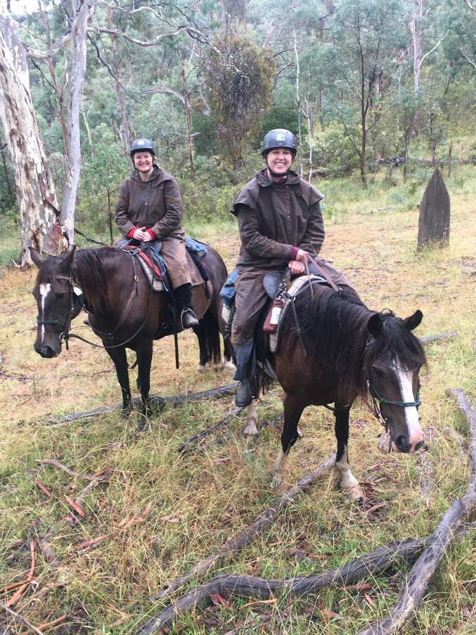 Riding horses in Australia in the rain, Snowy River style
