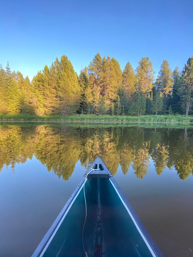 Winchester Lake canoe and trees reflection