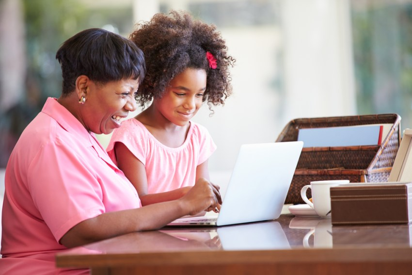 Grandmother and Granddaughter Together on Laptop