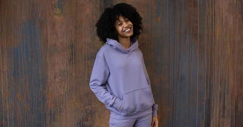 cheerful young black woman smiling at camera