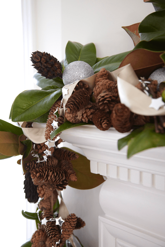 Decorating with Magnolia   Janet Brown Interiors    Holiday display goes natural with magnolia leaves  spruce  and pinecones  accented with silver        Decorating  Holiday Mantels     Traditional Home