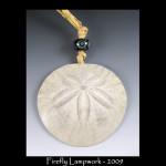 "Sand Dollar Ornament and ""batik"" bead"