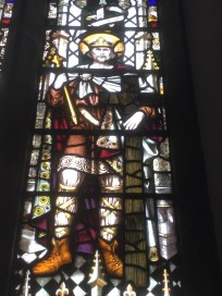 Detail of stained glass window depicting Saint Oswald, the Northumbrian warrior king.