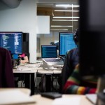 Two women working on coding in a tech office