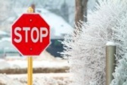 16915429-stop-road-sign-in-snowy-day-in-winter-canada