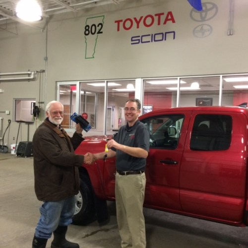Woody gets the keys from 802 Toyota salesman, Corey Morine