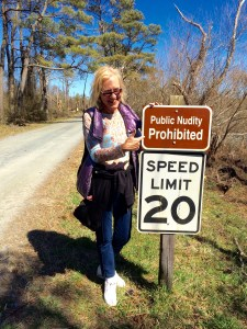 Here's Susan at a sign we found in the woods.