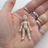 This tiny the doll is only 1 3/4 inches high. Yup. Weeny!