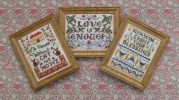 'Cat', 'Love is enough' and 'Count your blessings' miniature samplers - each measures two inches by two and a quarter inches. Available from www.janetgranger.co.uk