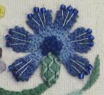 Stumpwork cornflower on the bride's Bag