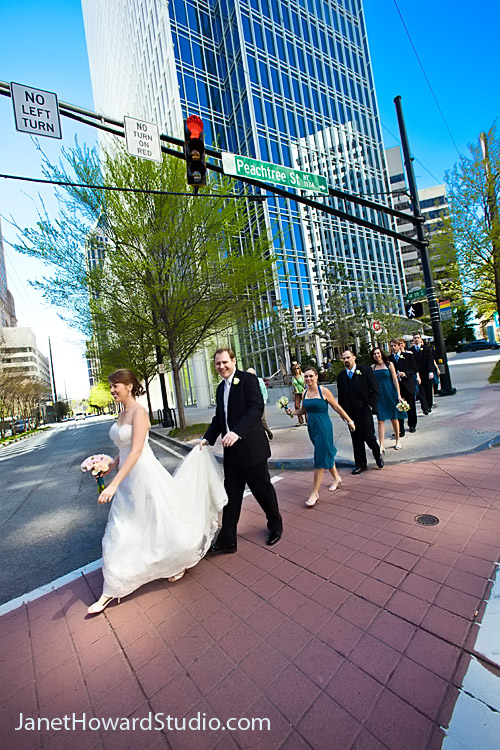 Wedding party crossing the street